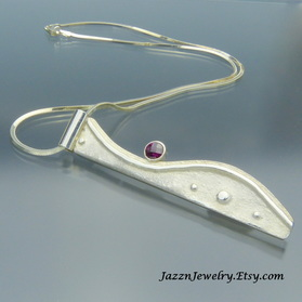 Tufa Cast Pendant with Garnet